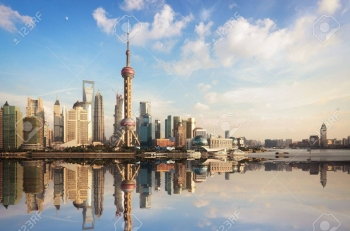 16159580-shanghai-skyline-at-dusk-with-reflection-china
